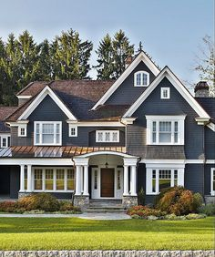 A traditional exterior feels even more timeless thanks to the navy paint accented with crisp white for contrast.