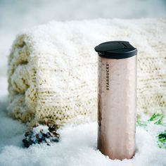 A+stainless+steel+coffee+tumbler+with+a+beautiful+hammered+texture+and+rose-gold+finish.