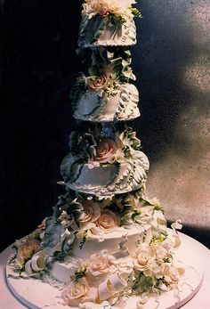 All edible cake with buttercream ribbons flowing around the cake. White chocolate roses