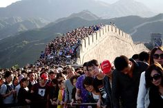 If you plan on going sightseeing right now in China, you might want to reconsider. That is, unless you like huge crowds and being pressed up against strangers. In China, China National Day, China Tourism, Tourism Development, Expectation Vs Reality, Great Wall Of China, Wonders Of The World, Places To See, Dolores Park