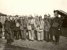 Fire fighters wearing gas masks. The photograph was taken in the 1920s.