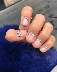 Negative space and tiny nail art ideas for you to try at your next manicure.