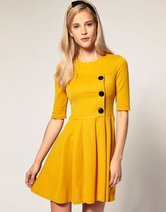Yellow button dress. <---- I can't wear this color, but I love it! And the cut of the dress. <3