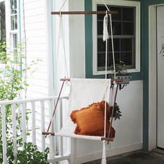 Make your own hanging lounge chair with some dowels, canvas, and rope.