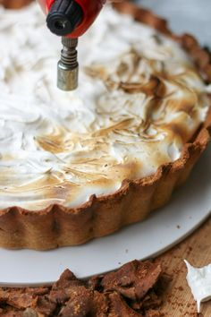 Our dairy-free version of a Sweet Potato Pie has a perfect velvety texture, crunchy ginger base and toasted marshmallow topping. I swear it's divine! | www.castironcookie.com