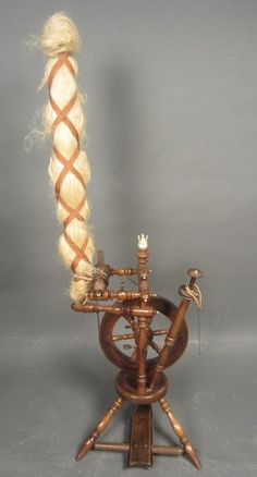"Antique spinning wheel with ivory finial. Height: 52"", Width 16"""