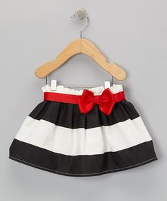 Designed with bold stripes and a contrast-color bow, this versatile skirt makes mixing and matching as easy as pie.