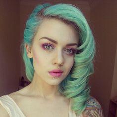 Eeeee, lip piercing trifecta! Pretty lady! Shiny earrings! Pink eyeshadow!!!!