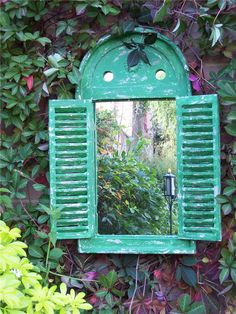 renaissance garden mirror with opening shutter doors green