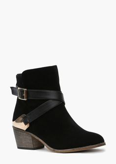 Black ankle boots with a chunky heel.