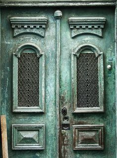 Alfama Doors by Ivy Dawned@flickr.com    Much of Lisbon could do with a nice coat of paint.