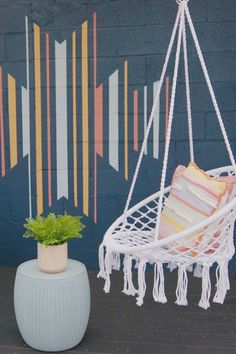 Add a bold mural to make your space pop! This graphic design is simple to replicate and fun to create when you're using bright colors from Behr Paint. Click this pin to find your perfect paint palette! #Sponsored by Behr