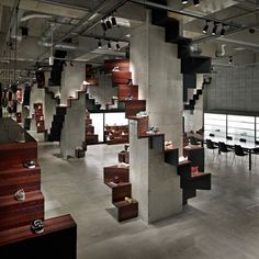 The use of dark timber in this Puma Store by Nendo works well to contrast the stark, unforgiving nature of the building it sits within; adding warmth, as well as feature displays, to the space. The contrasting dark area within the store also makes good use of the timber's warmth and provides a clear backdrop for company branding.