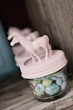Cute party favors that can be made with small jars, plastic horses, pink spray paint, and hot glue.