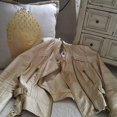 Faux leather Perfect condition .. Love this light weight sleek golden metallic chic jacket ....No flaws and firm.. I am med fit and it's a good fit ! ana Jackets & Coats