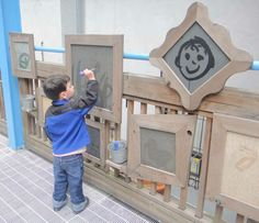 painting with water on pieces of framed slate ≈≈ http://www.pinterest.com/kinderooacademy/preschool-outdoor-play-environments/