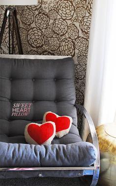 tufted chair, pretty print, and a heart pillow. cute!