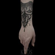 Elegant wrist tattoo by Kid Kros.