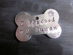 """Thinking of ordering this ID tag for Ollie. It has """"I rescued my human"""" inscribed on the back. So cute! $5.95"""