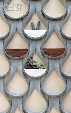 Editors' Picks: 41 Powerful Building Products | Felt Droplet wall-mount shelf and planter system in felt, Baltic birch, and brass by Garman Furniture #design #products #interiordesign #interiordesignmagazine