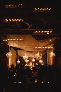 Wedding ceremony decor tip: Place candles on shelves for a subtle and romantic splash of light   Kristyn Hogan / Angela Proffitt