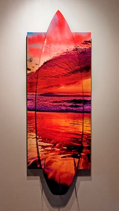A one in a million fiery sunset at Seaside state beach in Cardiff, California lights up the sky with waves of color. A unique combination of a photo-wrapped surfboard mounted in perfect registration to the print the board mounts on top of the print to produce a 3D art surfboard not to be seen anywhere but the Aaron Chang Ocean Art Gallery. Call the gallery at: (858)345-1880 for inquiries.