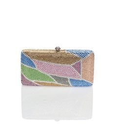"""Crystal rhinestone clutch with push clasp closure Includes optional strap Dimensions: 6.5 x 3.5 x 1.5 inches Composition: 100% base metal, crystal, vinyl Fits iPhone and Samsung Galaxy Push clasp closure 23"""" strap drop, optional By Natasha; imported."""