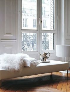 A vision of white and tan through the eyes of a Parisian apartment. Weathered oak floors, fur, ornate mouldings, Juliette balconies, silver teapots. Love it! - Jack