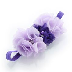"""Lavender, purple  Stretchy elastic headbands with three 2.25"""" fabric chiffon flowers attached.  The flower is attached to an elastic headband sized to fit newborns through around age 8mos.  We chose a narrow 3/8"""" width fold over elastic band for our infant size as we love how they are more petite for the little ones!  Perfect for all occasions from dressy-casual to formal and is darling as a photo prop hair accessory!  Age: newborn through 8mos. (13.5"""" - 15.5"""" head circumference)"""