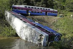 Workers investigate the scene of a derailed Altamont Corridor Express train in Sunol California [OS] [1280x865]