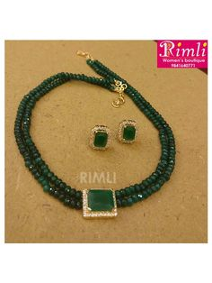 Simple choker with two layer tire shaped bottle green beads with a zircon locket set.Available at Rimli Boutique, T Nagar, Chennai.