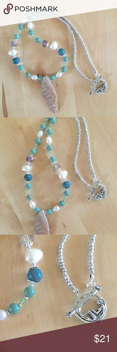 """NEW Beachy Necklace Mother of Pearl Mermaid Brand New - Handmade - AROIS Products  Unique, one-of-a-kind beachy necklace. It has a large, mother of pearl pendant set against green and blue gemstones, chalk turquoise, sky jasper, freshwater pearls and Czech glass beads. It has an eye-catching mermaid toggle clasp.   18"""" Long / 2"""" x 3/4"""" Mother of Pearl Pendant / Gemstone & Czech Glass Beads / Silver Plated Toggle Clasp / Glass Seed Beads  ~ Bundle three or more listings for a private offer…"""