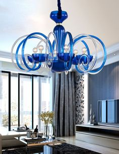 Elegance and beauty is surely not the only thing the Nays family will bring to any home. Illuminate your homes with this modern curved in Glass Ornamental Arms. Columns, Glass Made Good Quality, Bells and Bobeches with Hanging Precision Cut Droplets. Blue Chandelier, Chandelier Lighting, Chandeliers, Made Goods, Ceiling Lights, Elegant, Glass, Modern, Chandelier