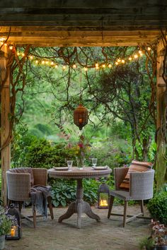 "Patio and ideas Patio is a Spanish term which actually means ""court yard"". A patio is usually utilized for recreation or dining purposes and is basically an Outdoor Areas, Outdoor Rooms, Rustic Outdoor Spaces, Outdoor Patios, Cozy Backyard, Desert Backyard, Patio Lighting, Lighting Ideas, Dream Garden"