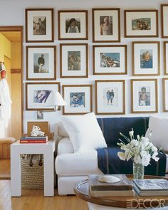 Vintage color family photos in wood frames - gallery wall in Ralph Lauren's home