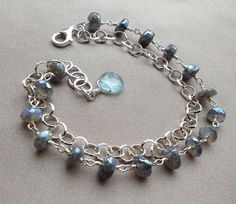 Double Layered Bracelet; Labradorite gemstones paired with sterling silver.Extended links included, providing a maximum length of 7 3/4.($38) Only one available.