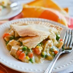 Easy Chicken Pot Pie - I made this with a few changes. I used a bag of frozen peas and carrots (instead of mixed veggies). I added a drained can of diced potatoes. I used a rotisserie chicken instead of cooking up my own (easier). I got a deep dish frozen 2-pack pie crust to use (comes with their own tin, so I wouldn't have to search for mine. I also added 1/4 tsp salt. Everyone loved it!
