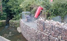 David's Curved gabion wall protecting against river erosion. Gabion Retaining Wall, Retaining Wall Design, Gambion Wall, Gabion Baskets, Landscape Solutions, Cinder Block Garden, Pony Wall, Riverside House, Commercial Landscaping