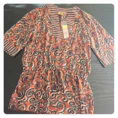 Tory burch Sapello silk swim coverup tunic, xs/s Sheer Tory tunic/coverup. Can be worn over a bathing suit, or over a cami and leggings. Material is a burnt orange/sienna with navy and white/gray accents. It's 100% silk. Brand new, with tags still attached. Tory Burch Tops Tunics