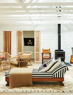 """""""I was inspired by a mash-up of surf shack, safari camp and Dutch colonial styles,"""" says Sam of her hunting cabin in Frontenac County, Ontario. Surf Shack, Beach Shack, Beach Cottage Style, Beach House, Airy Bedroom, Timeless Bathroom, Surf Design, Global Style, Cottage Design"""