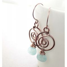 Swirly copper earrings with hoops and soft blue aquamarine color jade stones