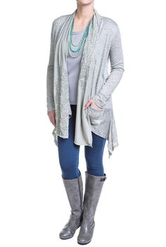This silvered green cardigan is lightweight and dripping in details. The muted green is heathered with silvery gray while the suede finish accent panel around the collar looks like a matching scarf, complete with swirling em
