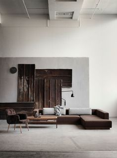 Minimalism makes a huge statement in this living room. Artwork isn't even needed because there is the perfect amount of wow happening. Straight lines work well in this fab space.