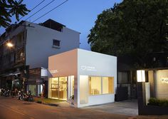 party space design has created a simple white construction for common room cafe in bangkok.