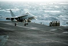 """One of our birds coming in for a perfect """"three wire"""".  (USS Coral Sea, CV-43)"""