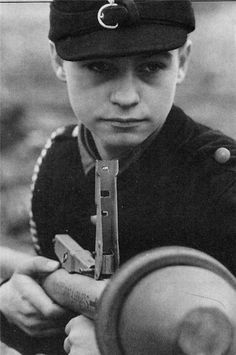 a German teenager from Volkssturm (a volunteer militia), armed with a Panzerfaust, is waiting for the Russian tanks (Berlin, 1945)