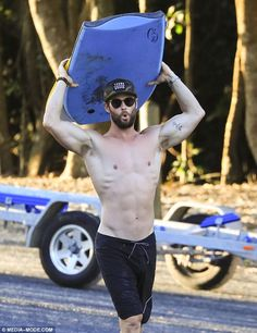 Easy on the eye: The Hollywood hunk flaunted his bulging biceps and washboard abs