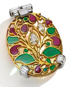 Gold, Platinum, Diamond and Colored Stone Mughal Style Brooch, Cartier, London, Circa 1925. The openwork oval-shaped foliate design, centering two antique pear-shaped diamonds, further decorated by variously-cut emeralds and rubies, the frame set with baguette diamonds.