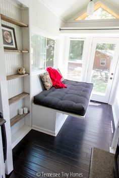 Have extra sleeping and sitting space anywhere with this leaf that turns a futon sofa into a bed- brilliant. The Big Mack | Tennessee Tiny Homes
