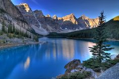 | Around the World in Pictures |    Valley of the Ten Peaks, Moraine Lake, @Alberta, Canada.    Moraine Lake is a glacially-fed lake in Banff National Park, 14 kilometres (8.7 mi) outside the Village of Lake Louise, Alberta, Canada. It is situated in the Valley of the Ten Peaks, at an elevation of approximately 6,183 feet (1,885 m). The lake has a surface area of .5 square kilometres (0.19 sq mi).